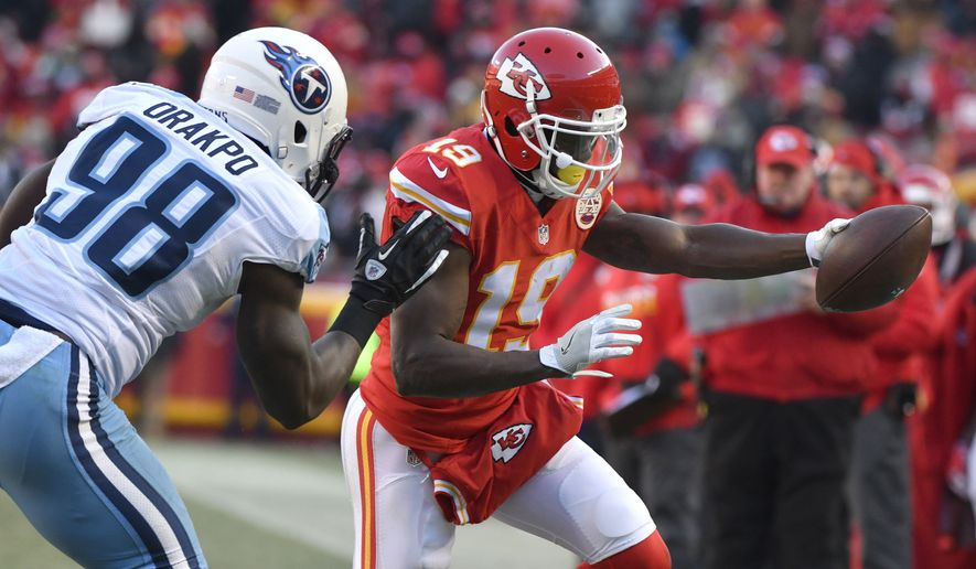 In this Dec. 18, 2016, file photo, Kansas City Chiefs wide receiver Jeremy Maclin (19) reaches for a first down next to Tennessee Titans linebacker Brian Orakpo (98) during an NFL football game in Kansas City, Mo. The Chiefs released Maclin in a stunning move Friday, June 2, midway through their voluntary workouts, bringing an abrupt ending to the tenure of what was arguably general manager John Dorsey and coach Andy Reid's biggest free-agent acquisition. (AP Photo/Ed Zurga, File)