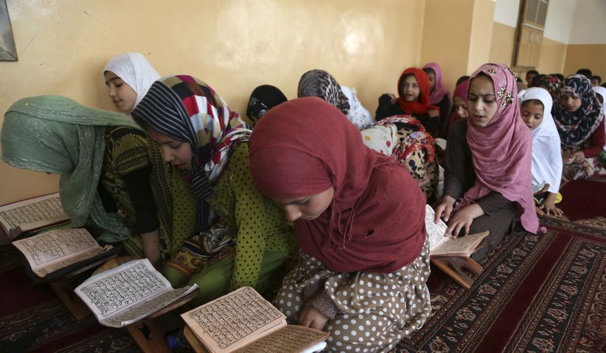Afghan girls learn to read the Quran, Islam's holy book, at a local Madrassa, or seminary, during the Islamic month of Ramadan in Kabul, Afghanistan, Tuesday, May 30, 2017. Muslims throughout the world are observing Ramadan, the holiest month in the Islamic calendar, refraining from eating, drinking, smoking and sex from sunrise to sunset. (AP Photo/Rahmat Gul)