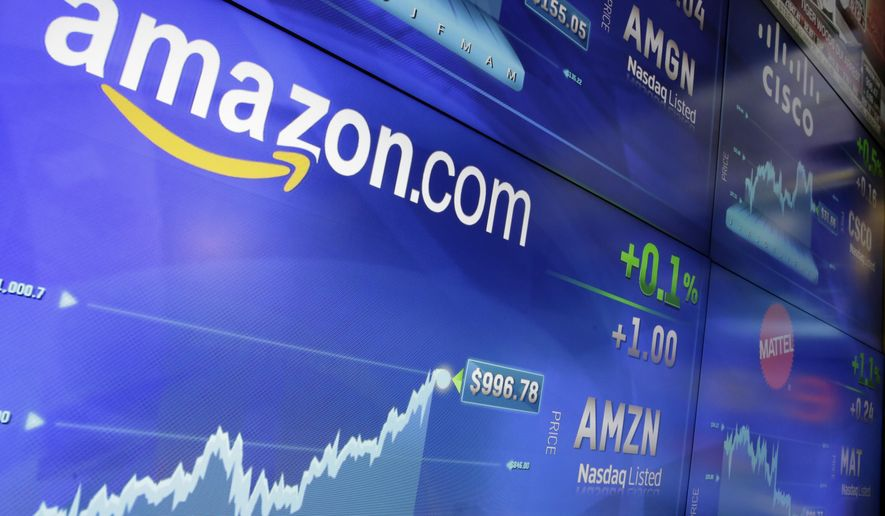FILE - In this Tuesday, May 30, 2017, file photo, the Amazon logo is displayed at the Nasdaq MarketSite, in New York's Times Square. Amazon is offering a discounted rate on its Prime membership for people who receive government assistance. The discounted rate is $5.99 per month. The regular annual membership is $99 per year, or $8.25 a month. But those who cannot afford to pay up front have to pay $10.99 a month for the same benefits. (AP Photo/Richard Drew, File)