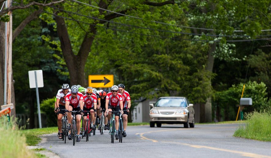 Members of the Chain Gang cycling club participate in a group ride on Tuesday, May 30, 2017  in Kalamazoo, Mich.    Wednesday, June 7,  marks the first anniversary of the incident in which cyclists with the Chain Gang Bicycle Club were mowed down from behind by a pickup truck driven by Pickett Jr. in Kalamazoo. Police say Pickett ingested handfuls of pain pills and muscle relaxers before the accident.(Jake Green /Kalamazoo Gazette-MLive Media Group via AP)