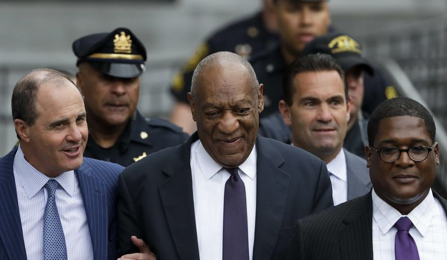 Bill Cosby walks from the Montgomery County Courthouse during his sexual assault trial, Tuesday, June 6, 2017, in Norristown, Pa. (AP Photo/Matt Slocum)