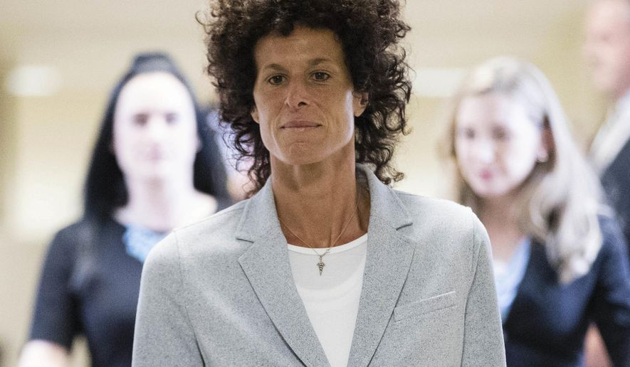 Andrea Constand walks to the courtroom during Bill Cosby's sexual assault trial at the Montgomery County Courthouse in Norristown, Pa., Tuesday, June 6, 2017. Cosby is accused of drugging and sexually assaulting Constand at his home outside Philadelphia in 2004. (AP Photo/Matt Rourke, Pool)