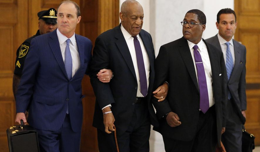 Bill Cosby, second from left, and Defense attorney Brian McMonagle exit the Montgomery County Courthouse during his sexual assault trial Tuesday, June 6, 2017, in Norristown, Pa. (Eduardo Munoz Alvarez/Pool Photo via AP)