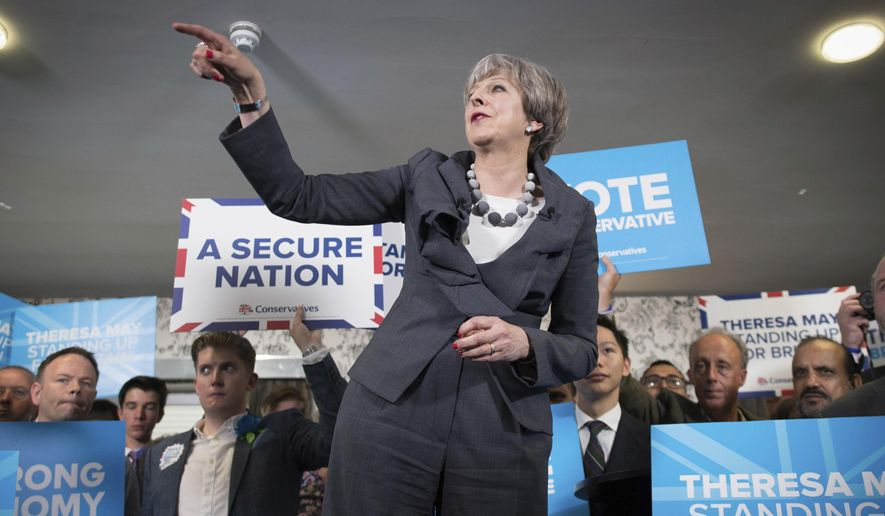 Britain's Prime Minister Theresa May makes a speech during her visit to Longton rugby club in Stoke central England while on the General Election campaign trail, Tuesday June 6, 2017. Britain votes in parliamentary elections on Thursday, June 8. (Stefan Rousseau/PA via AP)