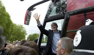Labour leader Jeremy Corbyn waves from his battlebus after a speech during General Election campaigning in Telford, England, Tuesday, June 6, 2017. The British election will take place on Thursday, June 8. (Ben Birchall/PA via AP)