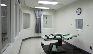 FILE - This Sept. 21, 2010 file photo shows the interior of the lethal injection facility at San Quentin State Prison in San Quentin, Calif. The California Supreme Court heard arguments over whether to block a voter-approved measure to speed up executions at a hearing in Los Angeles Tuesday, June 6, 2017. The case was brought by death penalty foes after voters approved Proposition 66 in November. (AP Photo/Eric Risberg, File)