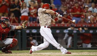 Cincinnati Reds' Scooter Gennett hits a two-run home run and his fourth overall in the eighth inning of a baseball game against the St. Louis Cardinals, Tuesday, June 6, 2017, in Cincinnati. The Reds won 13-1. (AP Photo/John Minchillo)