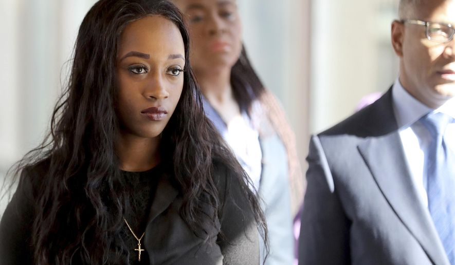 Diamond Reynolds, the girlfriend of Philando Castile, who live streamed his shooting on Facebook, arrives in court to resume her turn on the witness stand during the trial of police officer Jeronimo Yanez, Tuesday, June 6, 2017, at the Ramsey County Courthouse in St. Paul, Minn.  Yanez is charged in the July 6 death of Castile, a 32-year-old elementary school cafeteria worker, in a St. Paul suburb.  (David Joles/Star Tribune via AP)