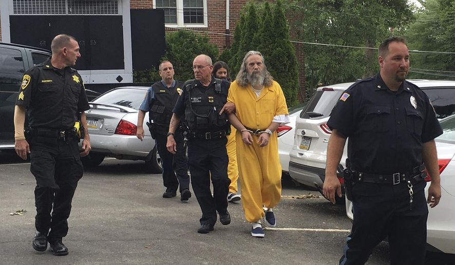 "FILE- In this Aug. 2, 2016, file photo, Lee Donald Kaplan, front in yellow, and Daniel Stoltzfus, back in yellow, are led to a preliminary hearing outside Bucks County Magisterial District in Feasterville, Pa. Kaplan was convicted Tuesday, June 6, 2017, of sexually assaulting six girls in the same family, fathering two children by one of them. Authorities allege the girls' parents had ""gifted"" their oldest daughter to Lee Donald Kaplan because he helped the family out of financial ruin. Jurors in Bucks County convicted Kaplan, 52, on all 17 counts of rape of a child, statutory sexual assault and other offenses. The conviction came a year after a neighbor's tip prompted authorities to search his Feasterville home.   (AP Photo/Megan Trimble, File)"