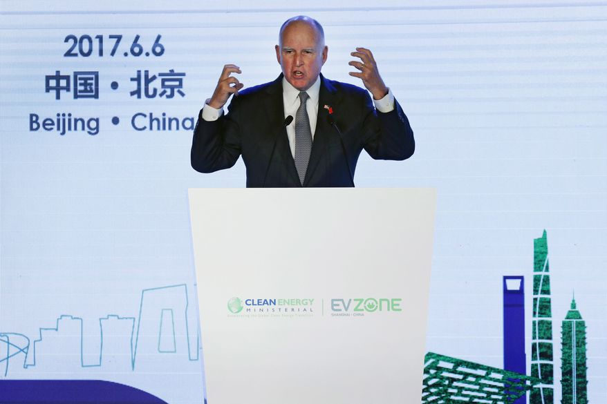 California Gov. Jerry Brown speaks during the Clean Energy Ministerial International Forum on Electric Vehicle Pilot Cities and Industrial Development at a hotel in Beijing, Tuesday, June 6, 2017. Brown predicts that President Donald Trump's decision to pull the U.S. out of the Paris climate accord will prove temporary because of the urgency of the issue. He told The Associated Press on the sidelines of a clean energy conference in Beijing on Tuesday that China, Europe and U.S. state governors will for now fill the gap left by the federal government's move to abdicate leadership on the issue. (AP Photo/Andy Wong)