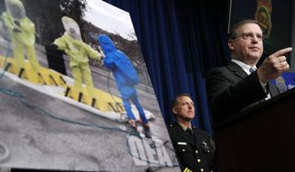 DEA acting administer Chuck Rosenberg, right, speaks about the dangers of fentanyl, at DEA Headquarters in Arlington Va., Tuesday, June 6, 2017. (AP Photo/Jacquelyn Martin)