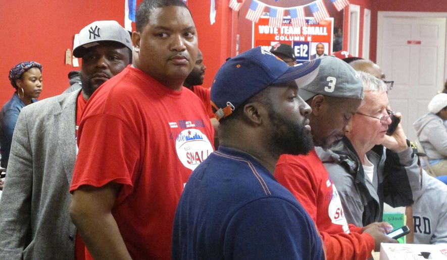 Atlantic City City Councilman Marty Small, second left, front, watches as election night return come in at his headquarters in Atlantic City N.J. on Tuesday June 6, 2017. Small was one of four Democrats running in the primary to become their party's nominee for mayor of Atlantic City. (AP Photo/Wayne Parry)