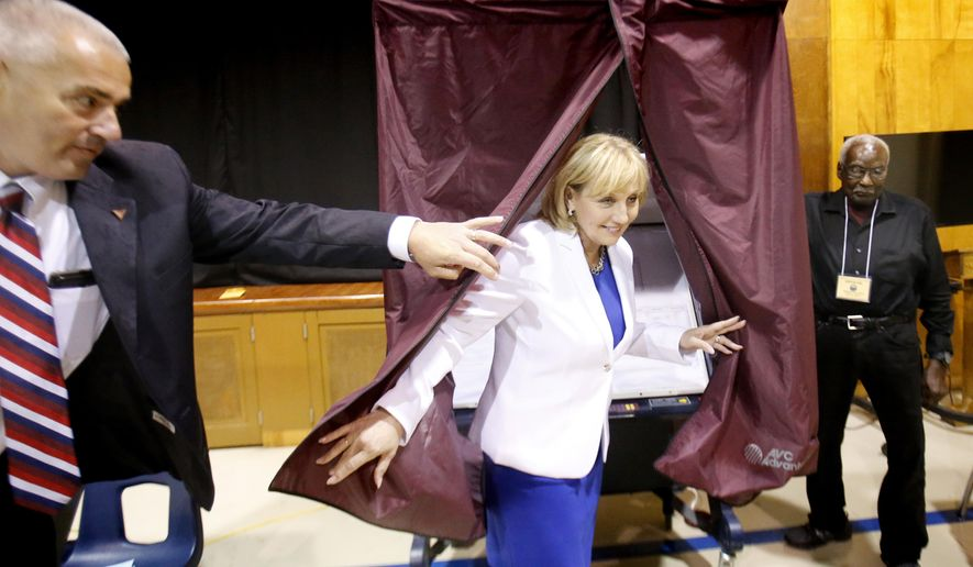 Lt. Governor Kim Guadagno leaves the both after voting during the primary gubernatorial election at the Church of The Precious Blood parish center, Tuesday June 6, 2017 in Monmouth Beach, N.J,  New Jersey voters are getting down to the business of picking a successor to Republican Gov. Chris Christie, the winners will go on to compete in the Nov. 7 general election. Phil Murphy is the leading Democratic candidate, while  Guadagno is the leading Republican.   (Aristide Economopoulos/NJ Advance Media via AP)