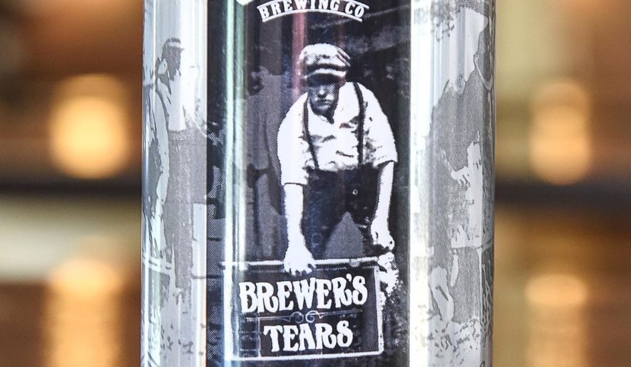 """In this Thursday, June 1, 2017 photo, Third Street Brewhouse newest beer dubbed """"Brewer's tears"""" is displayed  in Cold Spring, Minn. The pre-prohibition recipe by brewmaster Eugene Hermanutz was recently found in an old file cabinet at the brewery. (Jason Wachter/St. Cloud Times via AP)"""