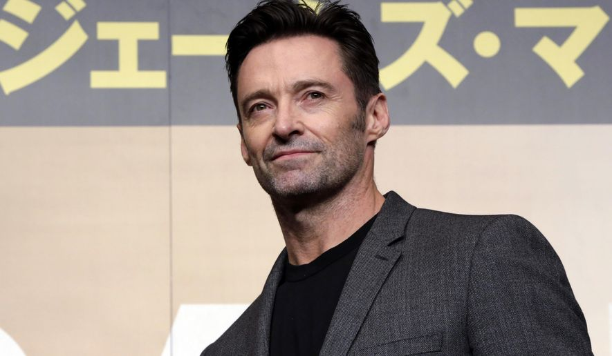 """FILe - In this May 25, 2017 file photo, actor Hugh Jackman poses for photographers during a press conference of his film """"Logan"""" in Tokyo. (AP Photo/Eugene Hoshiko, File)"""