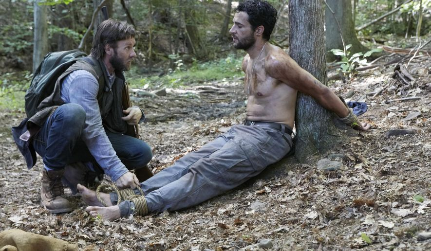 "This image released by A24 Films shows Joel Edgerton, left, and Christopher Abbott in a scene from ""It Comes At Night."" (A24 via AP)"