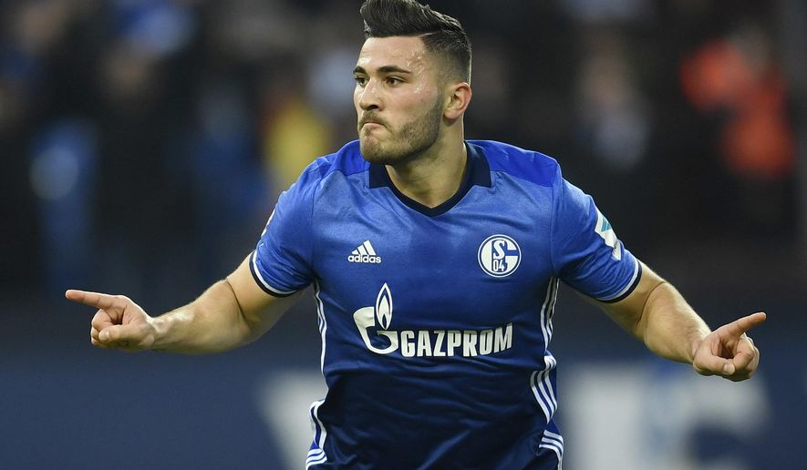 FILE - A Sunday, Nov. 27, 2016 file photo of Schalke's Sead Kolasinac celebrating his goal during the German Bundesliga soccer match between FC Schalke 04 and SV Darmstadt 98 in Gelsenkirchen, Germany. Arsenal says Bosnia-Herzegovina defender Sead Kolasinac will be the first signing of the 2017 summer transfer window. (AP Photo/Martin Meissner)