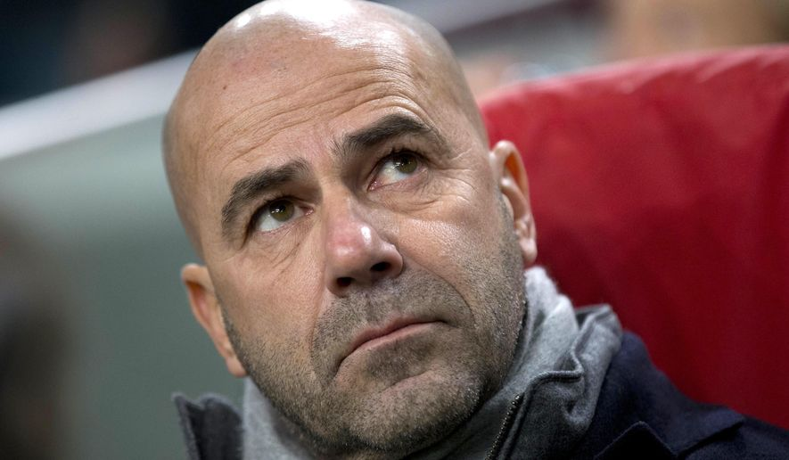 FILE - In this Nov. 24, 2016 photo Ajax's Peter Bosz waits for the start of the Group G Europa League soccer match between Ajax and Panathinaikos at the ArenA stadium in Amsterdam, Netherlands. (AP Photo/Peter Dejong, file)