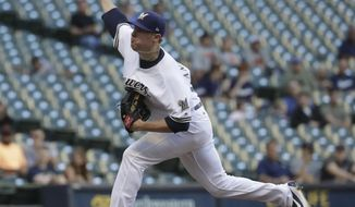 Milwaukee Brewers starting pitcher Chase Anderson throws during the first inning of a baseball game against the San Francisco Giants Tuesday, June 6, 2017, in Milwaukee. (AP Photo/Morry Gash)