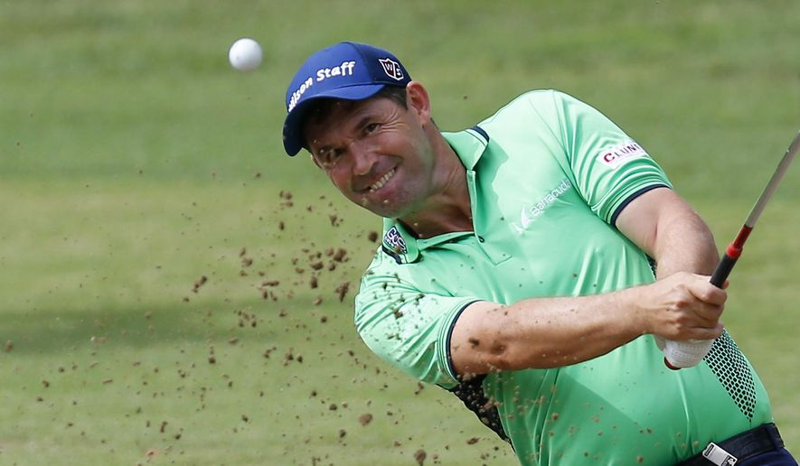 FILE - In this Sept. 16, 2016, file photo, Padraig Harrington hits the ball out of a bunker during the 73th Italy Open Golf Championship in Monza, Italy. Harrington was struck in the elbow doing a clinic and received six stiches, causing him to pull out of the FedEx St. Jude Classic this week. (AP Photo/Antonio Calanni, File)