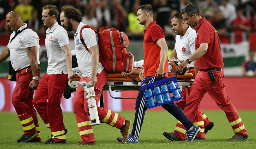 Russia's Roman Zobnin is carried off the field in a stretcher injured, during the international friendly soccer match between Hungary and Russia in Goupama Arena in Budapest, Hungary, Monday, June 5, 2017. (Tibor Illyes/MTI via AP)