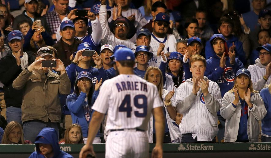 Fans give Chicago Cubs starting pitcher Jake Arrieta a standing ovation after he was pulled from the baseball game against the Miami Marlins during the seventh inning Tuesday, June 6, 2017, in Chicago. (AP Photo/Charles Rex Arbogast)