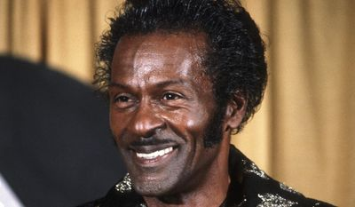 "FILE - In this Feb. 28, 1984 file photo, American singer and guitarist Chuck Berry is shown at the annual Grammy Awards in Los Angeles. Berry died March 18, 2017 at the age of 90.  His last album, ""Chuck,"" will be released on Friday, June 9, a fitting finale from the man who melded blues, rhythm and blues and country music into a sound that changed the cultural landscape. (AP Photo/Douglas Pizac, File)"