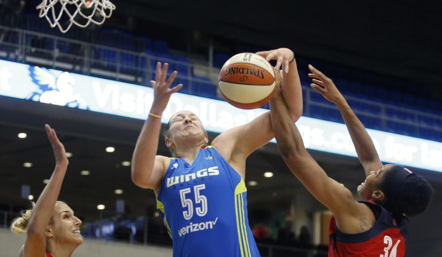 Dallas Wings forward Theresa Plaisance (55) attempts to get the rebound between Washington Mystics guard Elena Delle Donne (11) and center Krystal Thomas (34) during the first half of a WNBA basketball game in Arlington, Texas, Tuesday, June 6, 2017. (Vernon Bryant/The Dallas Morning News via AP) **FILE**