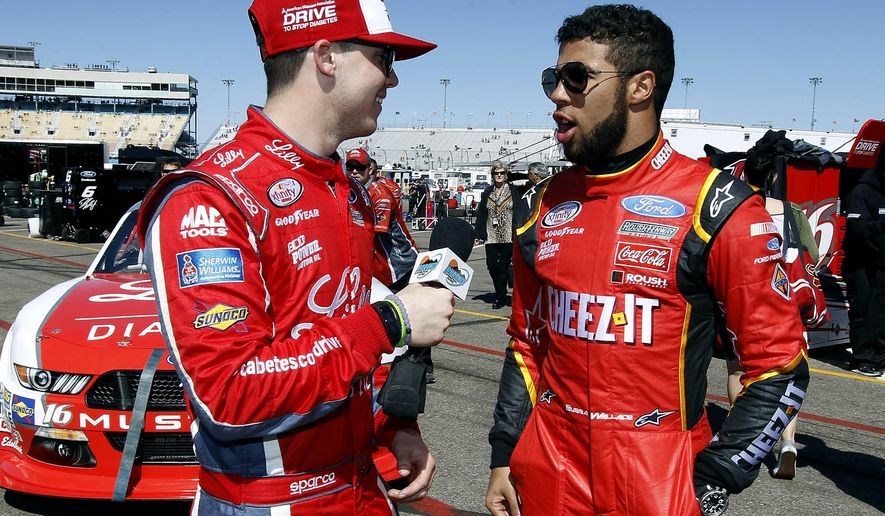 FILE - In this March 12, 2016, file photo, Ryan Reed, left, interviews fellow driver Darrell Wallace Jr. after NASCAR Xfinity Series qualifying at Phoenix International Raceway in Avondale, Ariz. Darrell Wallace Jr. will become the first black driver to race at NASCAR's top level since 2006 when he replaces injured Aric Almirola this weekend at Pocono Raceway. (AP Photo/Ralph Freso, File)