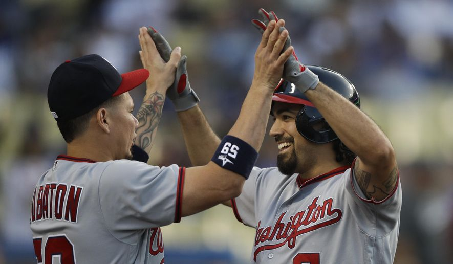 Washington Nationals' Anthony Rendon, right, celebrates his home run with Jose Lobaton during the second inning of a baseball game against the Los Angeles Dodgers, Monday, June 5, 2017, in Los Angeles. (AP Photo/Jae C. Hong)