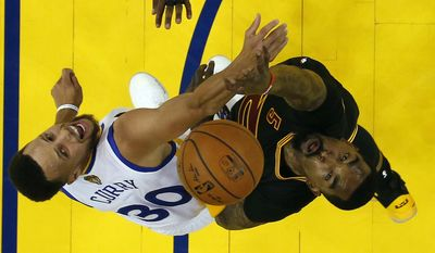 Cleveland Cavaliers' J.R. Smith, right, works for a rebound against Golden State Warriors' Stephen Curry (30) during the second half in Game 2 of basketball's NBA Finals Sunday, June 4, 2017, in Oakland, Calif. (AP Photo/Marcio Jose Sanchez, Pool)