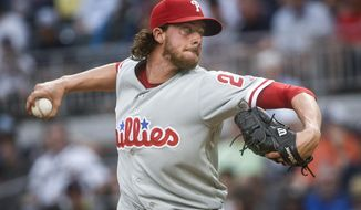 Philadelphia Phillies' Aaron Nola pitches against the Atlanta Braves during the first inning of a baseball game, Tuesday, June 6, 2017, in Atlanta. (AP Photo/John Amis)