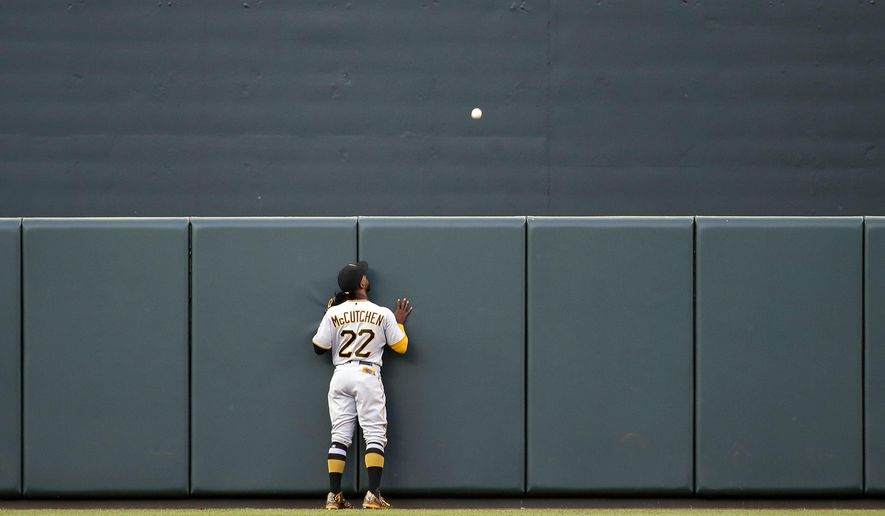 Pittsburgh Pirates center fielder Andrew McCutchen watches a solo home run ball that was hit by Baltimore Orioles' Seth Smith sail over the outfield wall in the first inning of an interleague baseball game in Baltimore, Tuesday, June 6, 2017. (AP Photo/Patrick Semansky)
