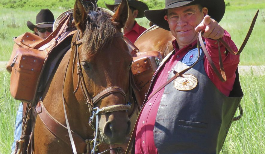 In this recent photo, Max Cawiezel, who has been directing Pony Express re-ride participants for the past 25 years, gestures in Scottsbluff, Neb. The National Pony Express Association, which keeps the memory of the short-lived mail service alive, will again relay mail by horse and rider over the famed Pony Express National Historic Trail next week to honor Nebraska's sesquicentennial. Cawiezel is in charge of the far western leg of the relay. (Steve Frederick/The Star-Herald via AP)