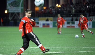 FILE - In this Tuesday, March 8, 2011 file photo, Chechen leader Ramzan Kadyrov runs during a friendly match between Chechnya and Brazil in the stadium in Grozny. A Russian league soccer club in formerly war-torn Chechnya is to be renamed after the regional leader's dead father. Terek Grozny CEO Akhmed Aidamirov said Tuesday, June 6, 2017 the club, which has previously won the Russian Cup, will be renamed Akhmat Grozny after Akhmat Kadyrov, the father of current regional leader Ramzan Kadyrov. (AP Photo/Musa Sadulayev, File)