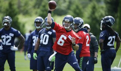 Seattle Seahawks backup quarterback Austin Davis (6) passes during NFL football practice as backup quarterback Trevone Boykin (2) looks on, Tuesday, June 6, 2017, in Renton, Wash. (AP Photo/Ted S. Warren)