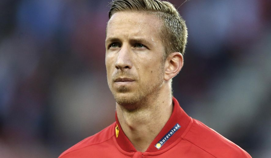 FILE - In this Tuesday, June 31, 2016 file photo, Austria's Marc Janko listens to the national anthem ahead of an international friendly soccer match against Malta, in Klagenfurt, Austria. Austria striker Marc Janko has moved to Sparta Prague on a two-year contract, it was announced on Tuesday, June 6, 2017. The 33-year-old towering player comes from Basel in Switzerland where he spent last two seasons after his contract there expired. (AP Photo/Darko Bandic, file)
