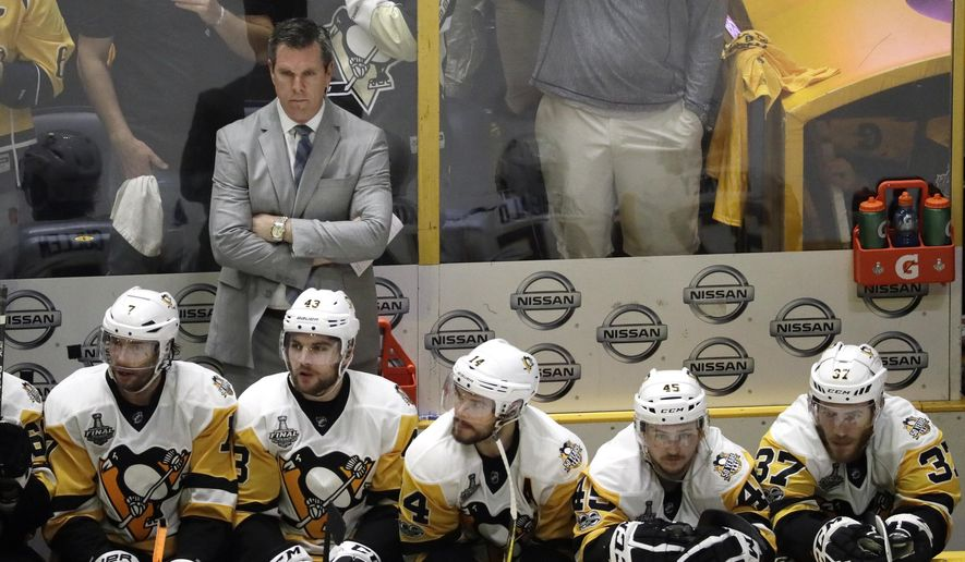 Pittsburgh Penguins head coach Mike Sullivan watches along with his players during the final minutes of the third period in Game 4 of the NHL hockey Stanley Cup Finals against the Nashville Predators Monday, June 5, 2017, in Nashville, Tenn. The Predators won 4-1 to tie the series 2-2. (AP Photo/Mark Humphrey)