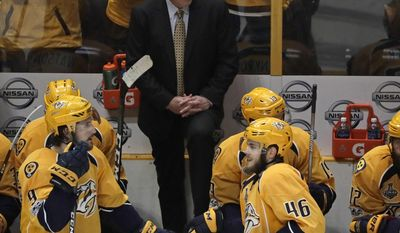 Nashville Predators head coach Peter Laviolette, center, talks with players during a timeout in the third period against the Pittsburgh Penguins in Game 4 of the NHL hockey Stanley Cup Finals Monday, June 5, 2017, in Nashville, Tenn. (AP Photo/Mark Humphrey)