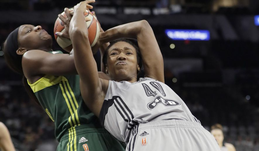 Seattle Storm forward Crystal Langhorne (1) and San Antonio Stars center Kayla Alexander (40) battle for control of a rebound during the first half of a WNBA basketball game, Tuesday, June 6, 2017, in San Antonio. (AP Photo/Eric Gay)