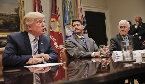 House Speaker Paul Ryan of Wis., center, and Senate Majority Whip John Cornyn, R-Texas, right, listen to President Donald Trump, left, speak during Trump's meeting with House and Senate Leadership in the Roosevelt Room of the White House in Washington, Tuesday, June 6, 2017. (AP Photo/Pablo Martinez Monsivais)
