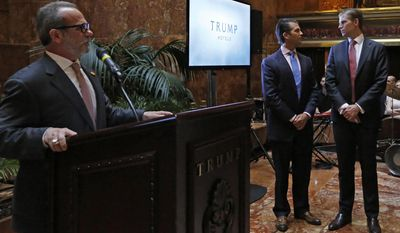 """Trump Hotels CEO Eric Danziger, left, speaks as Donald Trump Jr., center, and Eric Trump glance around the room during an event Monday, June 5, 2017, at Trump Tower in New York. The Trump Organization is launching a new mid-market hotel chain called """"American Idea.""""(AP Photo/Kathy Willens)"""