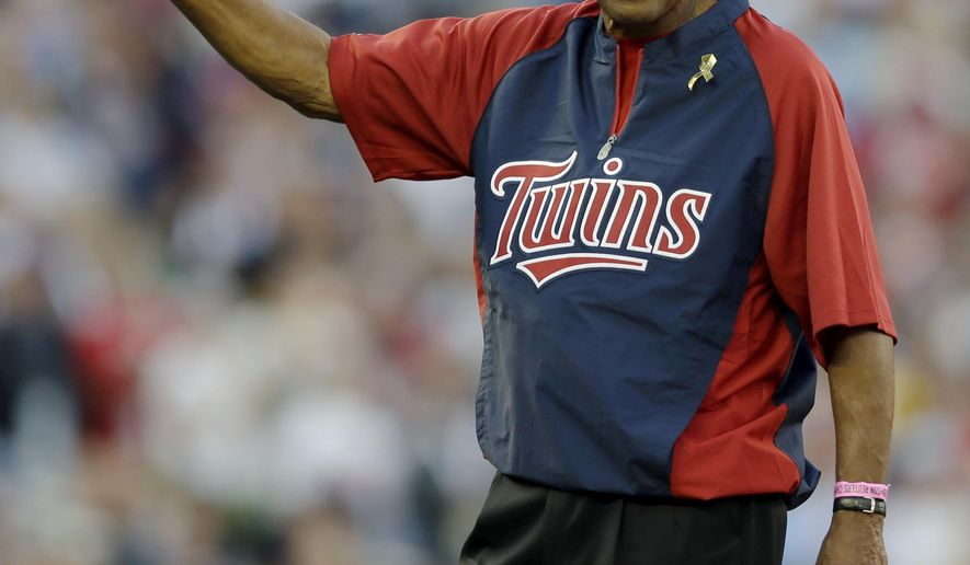 FILE - In this July 15, 2014, file photo, former Minnesota Twins player and Hall of Famer Rod Carew prepares to throw the first pitch before the MLB All-Star baseball game in Minneapolis. The Twins plan to welcome Hall of Famer Rod Carew back to Minnesota next month. The Twins said Tuesday, June 6, 2017 that Carew will return to Minnesota on July 3. It's his first trip to the state since receiving a heart and kidney transplant in December. (AP Photo/Jeff Roberson, File)