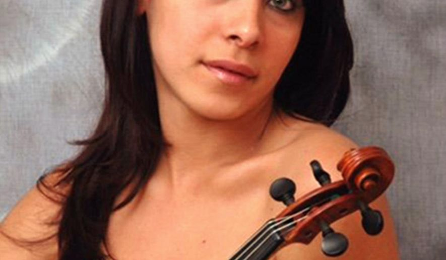 This undated publicity photo provided by her attorney, Philip A. MacNaughton, shows professional violinist Yennifer Correia in Venezuela. United Airlines says it wants to contact Correia, who says she was barred by a United supervisor from boarding a plane with her violin on Sunday, June 4, 2017, in Houston, leading to a scuffle that caused her to miss her flight and she thinks may have injured her hand. Correia and her attorney say the scuffle happened as the Memphis musician was preparing to fly to Missouri for a symphony rehearsal. (Yennifer Correia/Philip A. MacNaughton via AP)