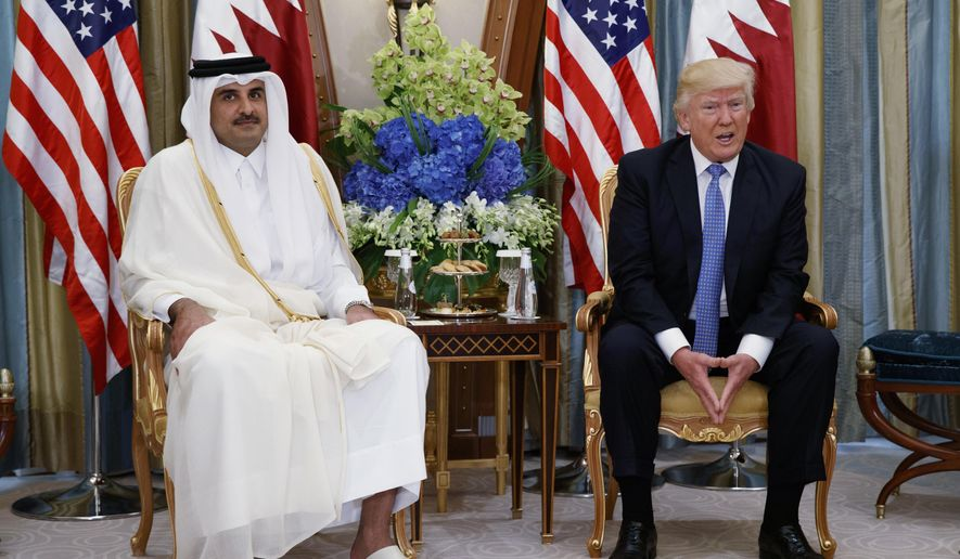 In this May 21, 2017, file photo, President Donald Trump, right, holds a bilateral meeting with Qatar's Emir Sheikh Tamim Bin Hamad Al-Thani, in Riyadh, Saudi Arabia. Trump sided with Saudi Arabia and other Arab countries Tuesday in a deepening diplomatic crisis with Qatar, appearing to endorse the accusation that the oil-rich Persian Gulf nation is funding terrorist groups. (AP Photo/Evan Vucci, File)