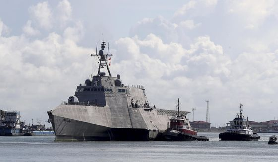 In this Saturday, June 3, 2017 photo, the U.S. Navy's newest littoral combat ship, USS Gabrielle Giffords arrives in Galveston, Texas.. The 421-foot USS Gabrielle Giffords will be commissioned this weekend in Texas. The ship is named for the former Arizona congresswoman, who in 2011 was shot but survived an assassination attempt in Tucson. (Jennifer Reynolds/The Galveston County Daily News via AP)