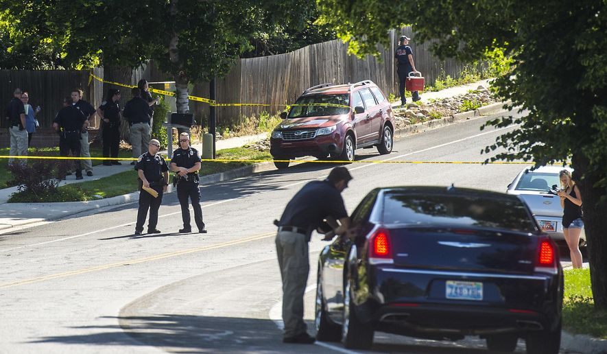 Police officers investigate the scene of a shooting in Sandy, Utah, Tuesday, June 6, 2017. Utah police say the shooter in a suburban Salt Lake City neighborhood is among several people who died in the incident and two others injured were children. The shooting took place on a neighborhood street in the suburb of Sandy, about 20 miles southeast of Salt Lake City.  (Chris Detrick/The Salt Lake Tribune via AP)