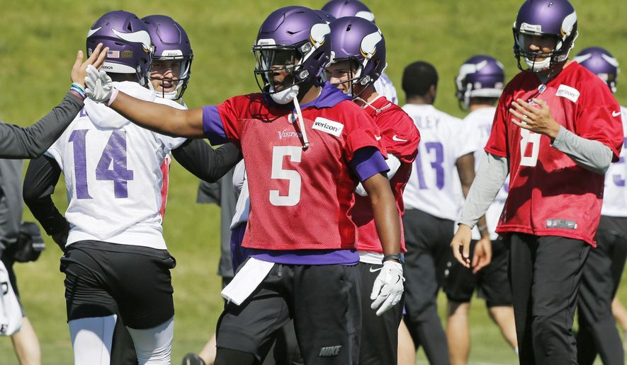 Minnesota Vikings quarterback Teddy Bridgewater (5) joins other quarterbacks including Sam Bradford, right, during the NFL football teams practice Tuesday, June 6, 2017, in Eden Prairie, Minn. Bridgewater is recovering from a knee injury that kept him out last season. Bradford was signed to replace him as starting quarterback. (AP Photo/Jim Mone)