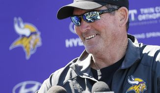 Minnesota Vikings head coach Mike Zimmer talks with reporters after an NFL football team practice Tuesday, June 6, 2017, in Eden Prairie, Minn. Zimmer is back at Vikings practice after being told to take a leave while recovering from an eighth eye surgery. (AP Photo/Jim Mone)