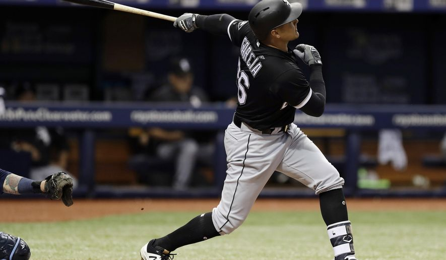 Chicago White Sox's Avisail Garcia follows the flight of his home run off Tampa Bay Rays starting pitcher Chris Archer during the seventh inning of a baseball game Tuesday, June 6, 2017, in St. Petersburg, Fla. (AP Photo/Chris O'Meara)